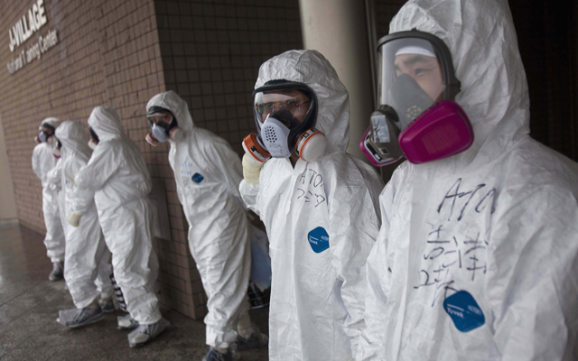 Fukushima workers sue Tepco over unpaid wages