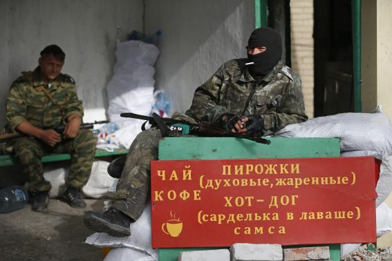 Ukrainian troops cross into Russia to avoid fighting, talks underway