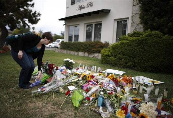 Father blames government 'idiots' as California town mourns killings