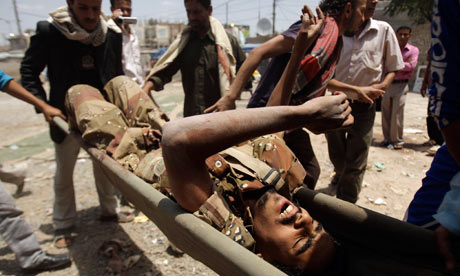 Yemen army fights in north and is attacked in south