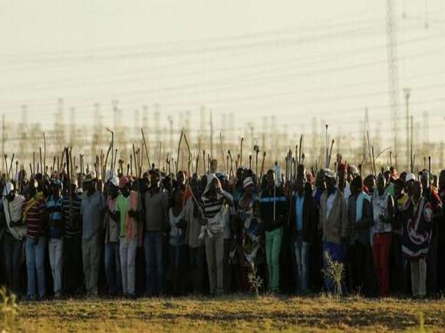 Miners beg union to end South Africa's longest strike