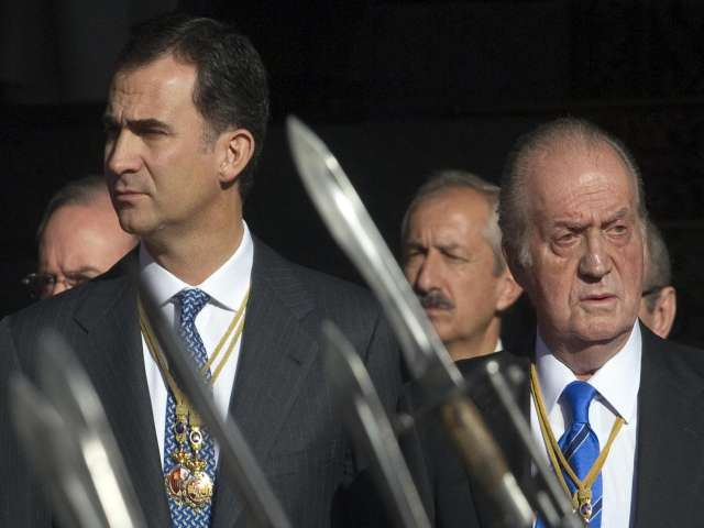 Spain's ex-King gets protection as suit possibility looms
