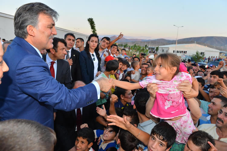 Turkey's Gul has iftar with Syrians in refugee camp