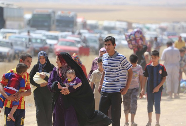 Clashes kill 21 in Iraq while Yazidis released