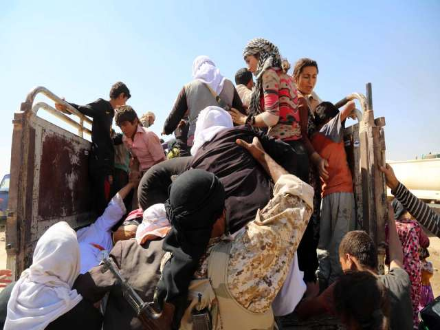 Hundreds of Yazidis arrive in Turkish tent city