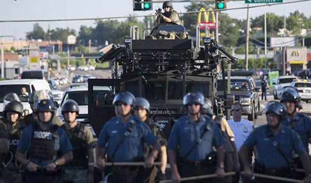 Obama orders review of U.S. police use of military hardware