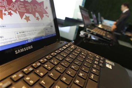 U.S. scientist pleads guilty to taking government laptop to China