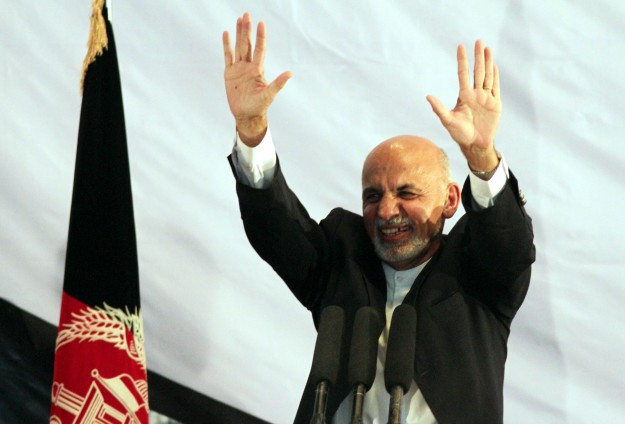 Afghanistan swears in new leader, Taliban talks on agenda