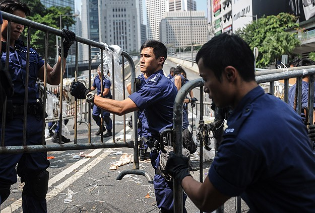 Hong Kong police haul protesters away as camp site is dismantled