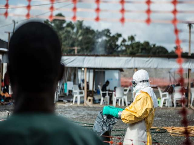 Ebola-hit Sierra Leone searches homes, bans festivities