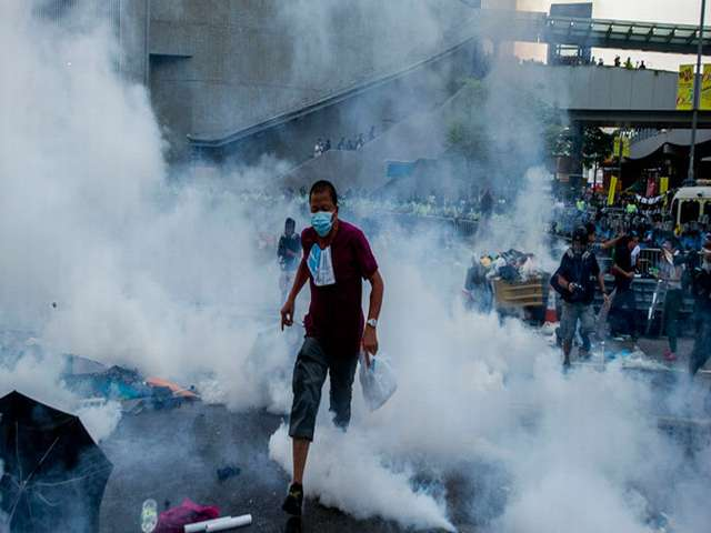 Street clashes erupt as HK police crack down on protesters