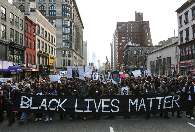 Thousands join anti-racism march in Boston