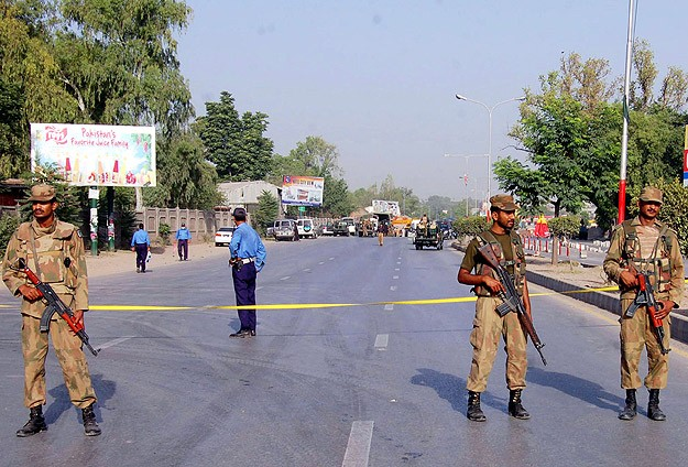 Pakistani forces reclaim school following gruesome attack