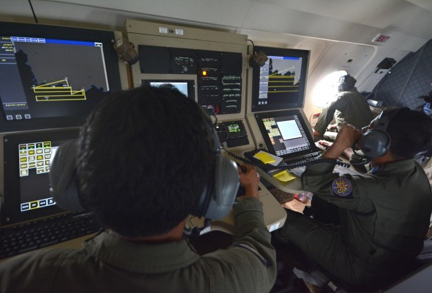 Indonesia navy says may have located missing plane's tail section