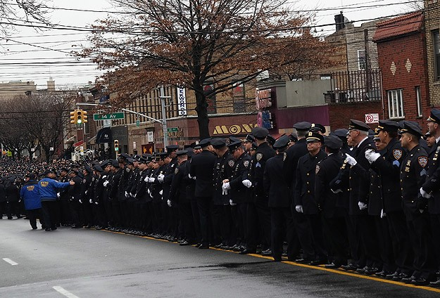New York police turn backs on mayor in officer's funeral