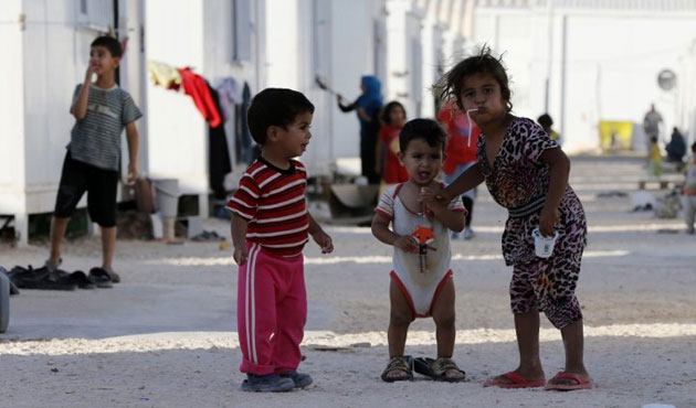 UK's PM urged to accept more Syrian refugees