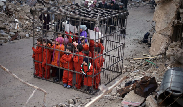 Syrian children protest Assad airstrikes in 'cage'