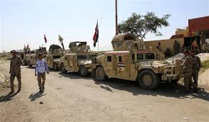 Iraqi forces push into Tikrit from north and south