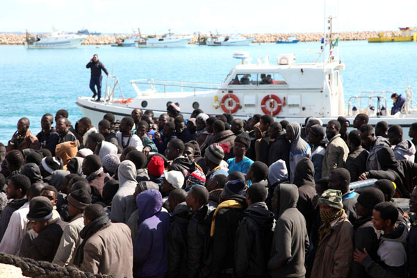 Italy sets up fast-track asylum courts for refugees