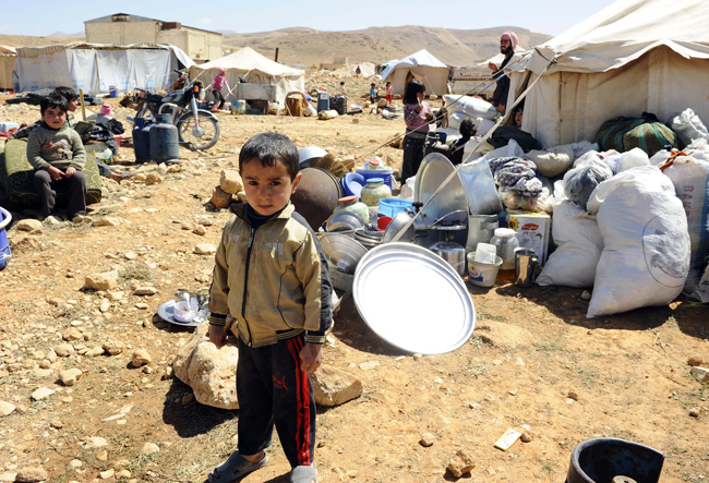 Syrians prevented from going back to Tal Abyad city