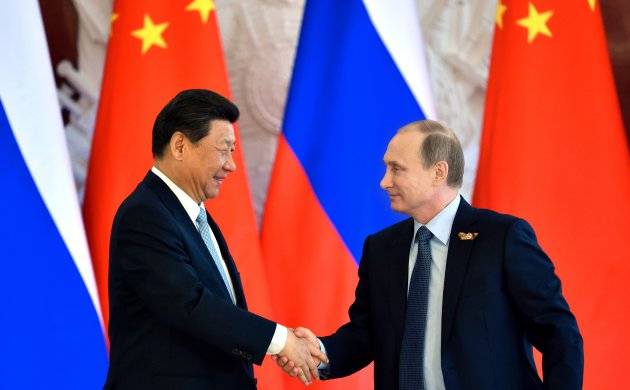 Russia and China sign 32 trade deals, deepen ties