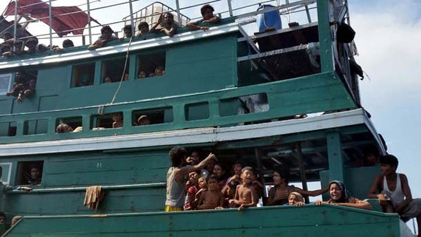 Thai navy tows migrant boat back out to sea