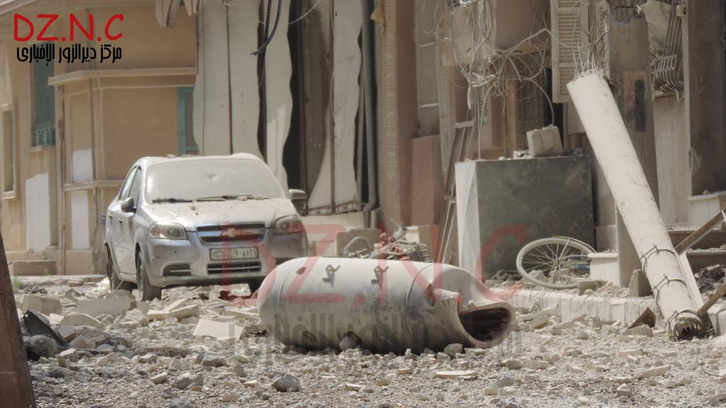 Barrel bombs kill 14 in eastern Syria