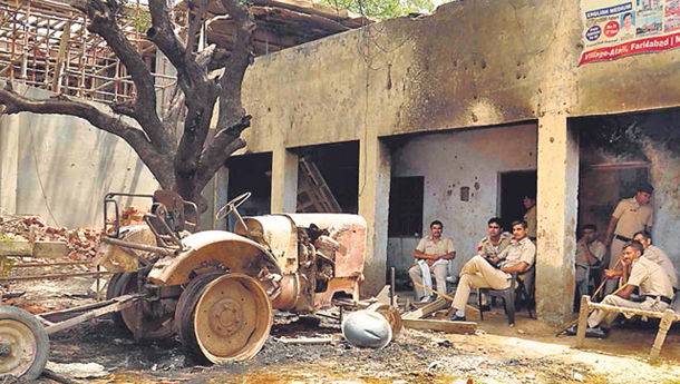 Muslim homes, mosque torched in India