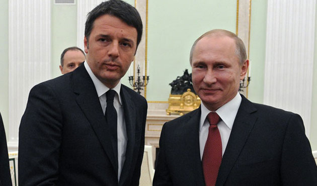 Putin calls in Italy for implementation of truce deal