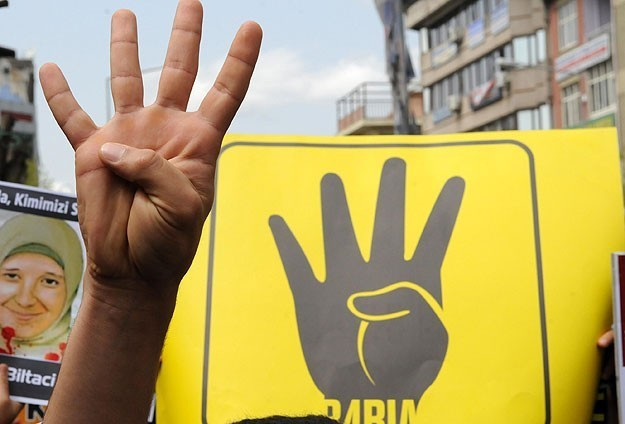 Rabia sign becomes anti-coup symbol in world