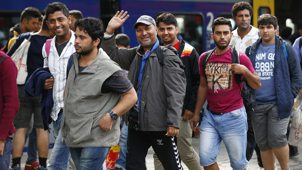 Germany adopts stricter asylum rules
