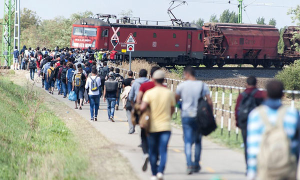 Hungary in state of emergency, refugees walk to Croatia