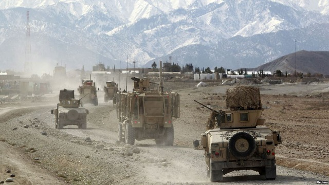 Afghan forces wrest key district from Taliban