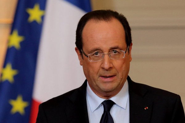 Hollande seeks 'global' refugee deal to include Turkey, Greece