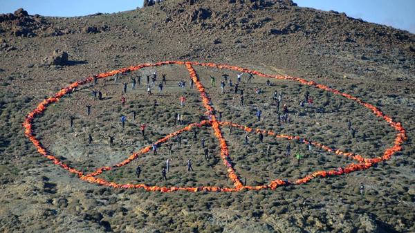 Refugee life jackets bring peace sign to life