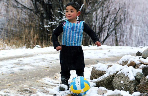 Afghan boy in plastic Messi jersey his biggest fan