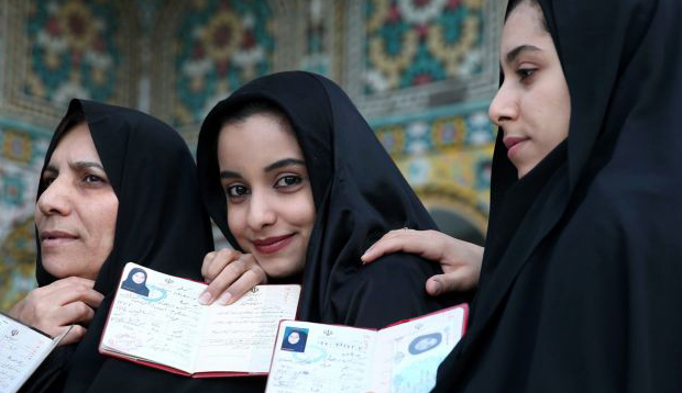 Iran awaits first results from double election