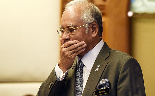 Malaysia's Najib hit with travel ban after poll loss