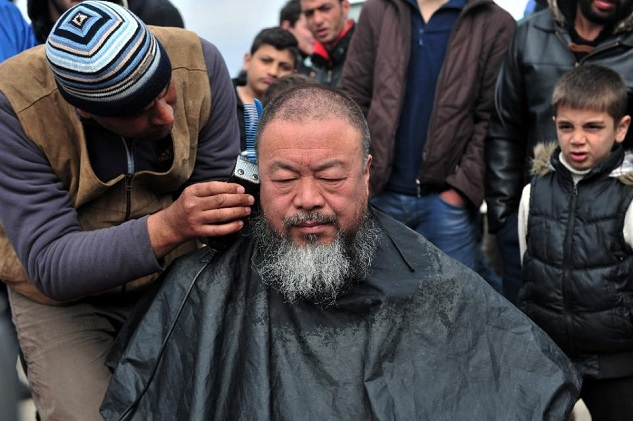 Ai Weiwei gets refugee haircut