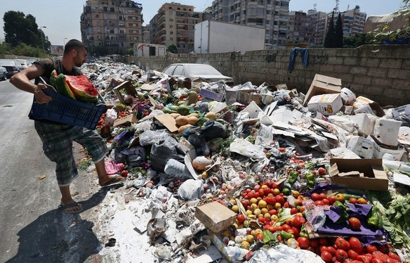 To flee Lebanon's trash crisis, family heads to Syria