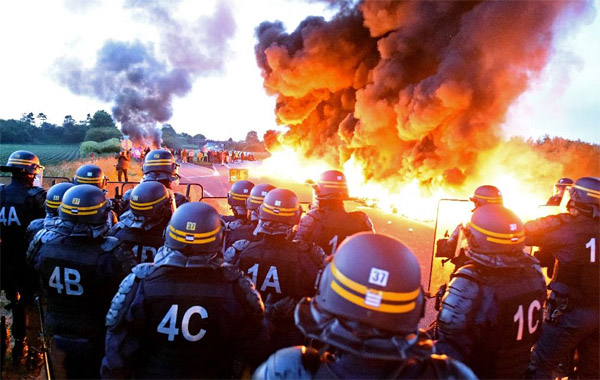 France dips into fuel reserves, nuclear workers join strikes