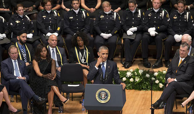 Obama pays respects to slain officers, urges unity