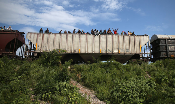 Migrants race to beat Trump's wall
