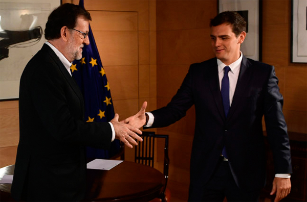 Spain parties strike deal to form government