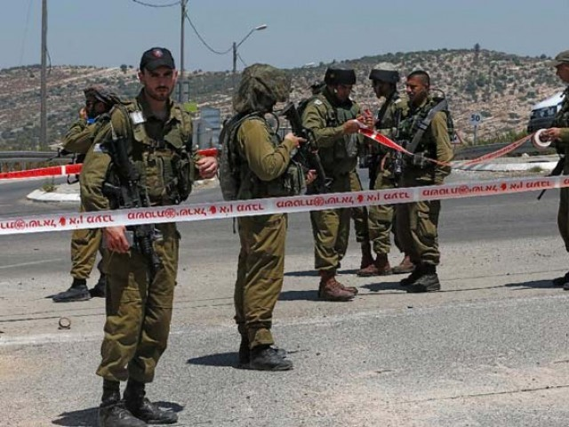 Israel rounds up 22 Palestinians in West Bank raids
