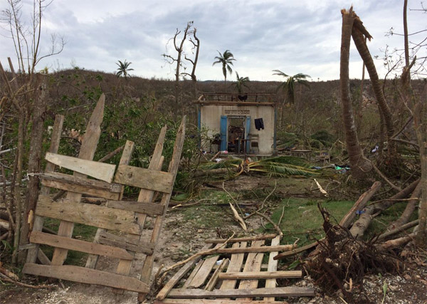 US to end protective status for Haitian quake victims