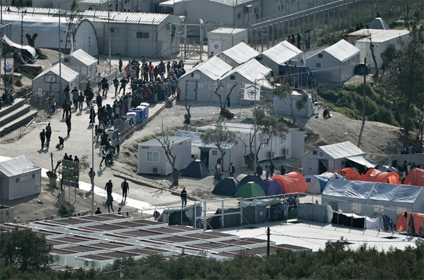Greece moves hundreds of migrants from Samos camp