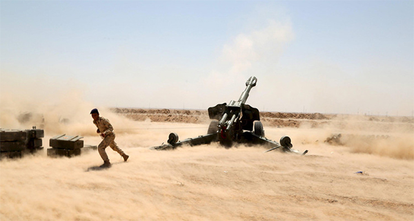 US-led coalition praises 'militias' fighting in Iraq