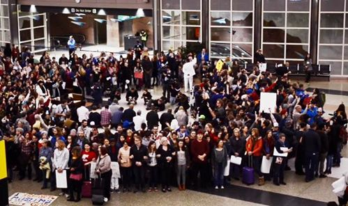 Crowd protect Muslims in prayer at Denver airport
