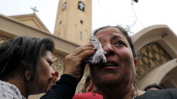 Egyptian church bells ring for mosque attack victims